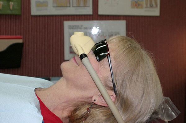 An elderly woman undergoing sedation dentistry.