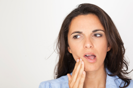 A woman suffering from a severe toothache.