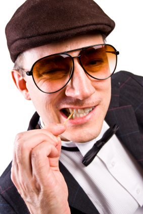 A man chewing onto a toothpick.